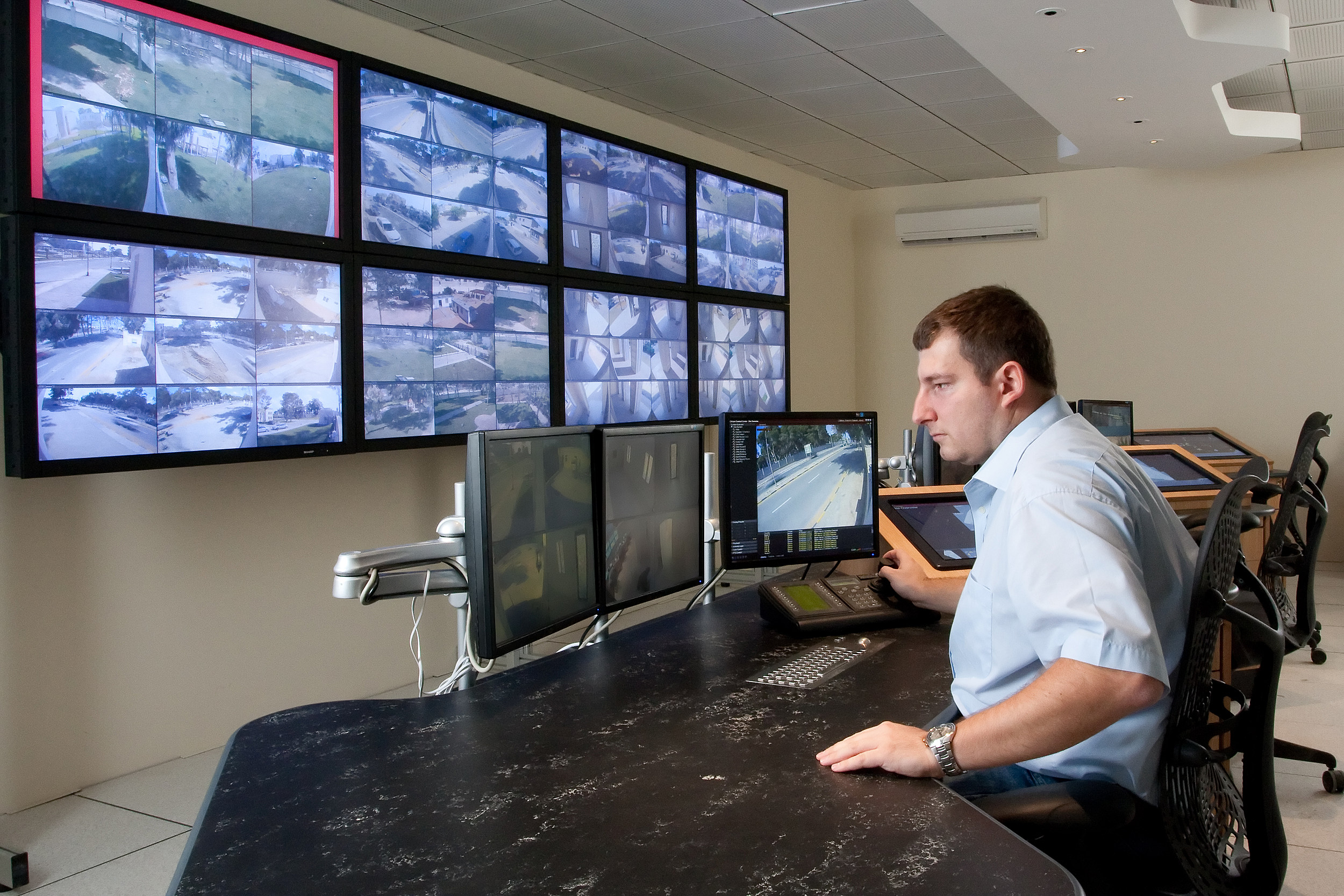 Man Monitoring Cameras